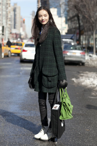 A plaid coat gave leather leggings a charming twist.