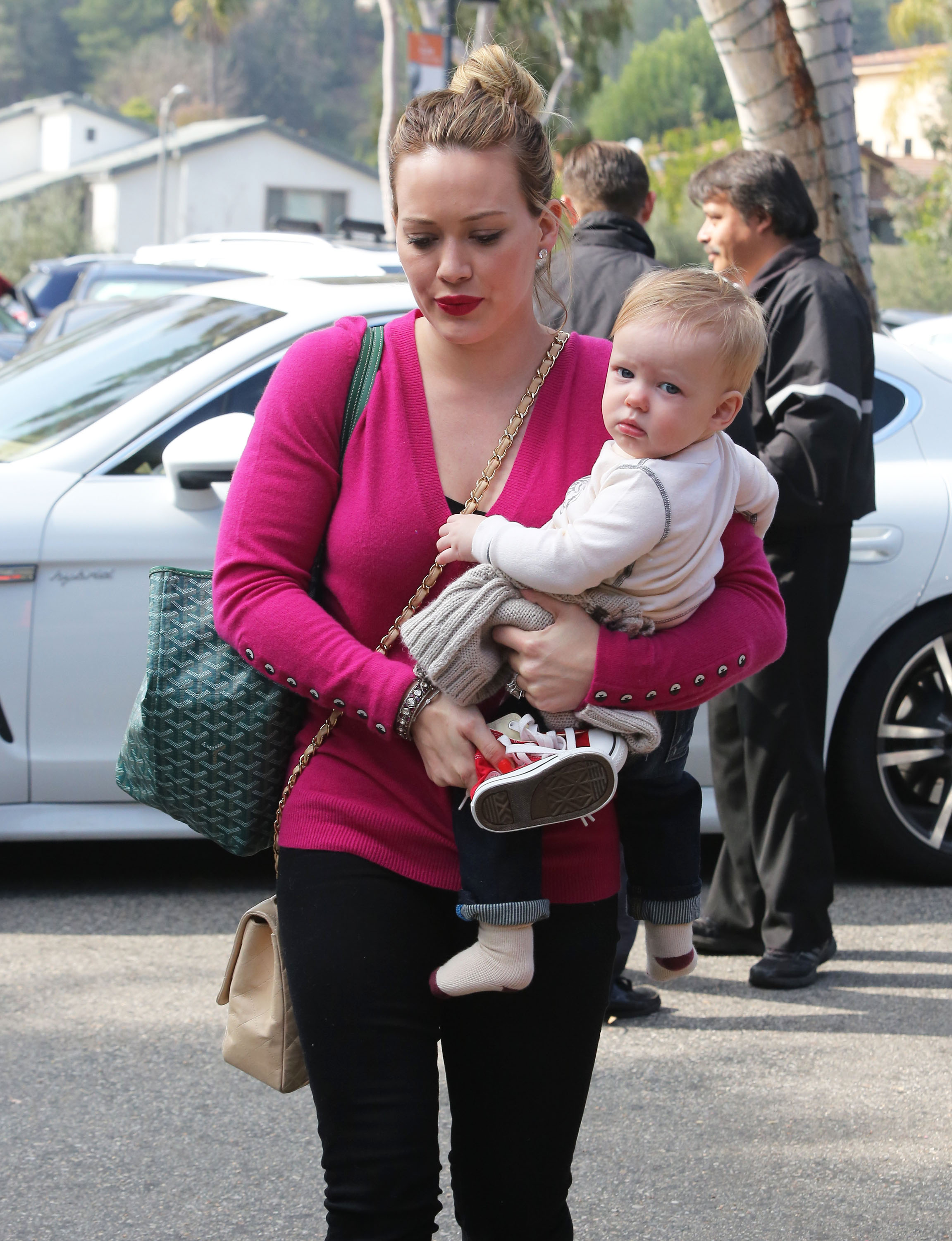 Hilary Duff carried Luca Comrie as she ran errands around LA.