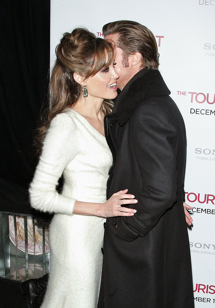Brad brought Angelina in for a kiss on the cheek at the NYC premiere of The Tourist in December 2010.