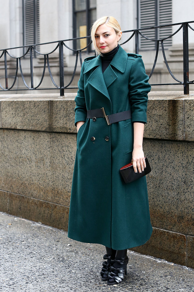 Gorgeous green outerwear was all this chic showgoer needed to draw our attention.