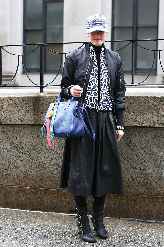Teen Vogue Mary Kate Steinmiller gave sporty appeal via an on-trend cap to a full leather skirt and buckled boots.