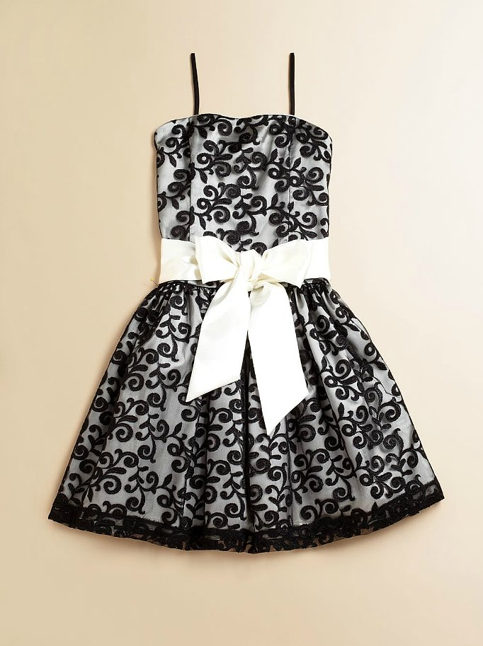 Your leading lady will turn heads in this black and white dress ($150) with a sweet bow and lace overlay.