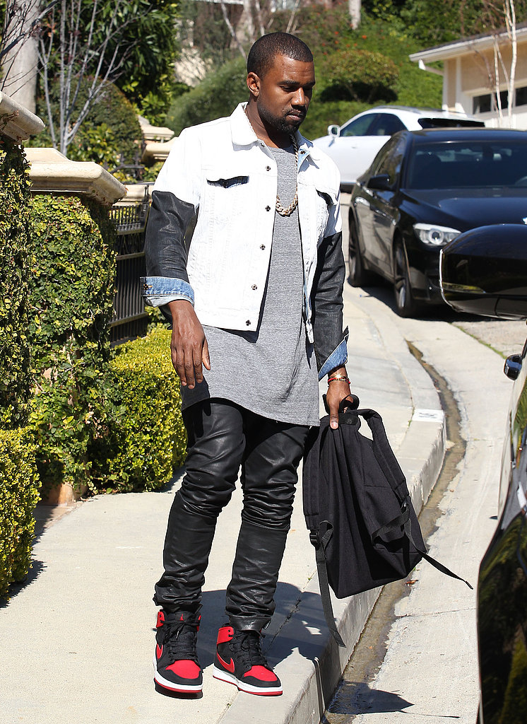 Kanye West wore leather pants to step out with girlfriend Kim Kardashian in LA.