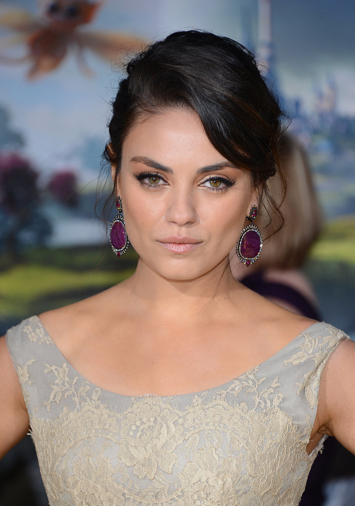 Mila Kunis wore a Dolce & Gabbana dress with purple jeweled earrings.
