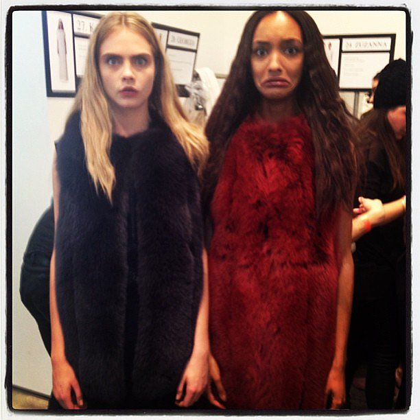 Cara Delevingne and Jourdan Dunn joked around in their fur outfits before hitting the runway. Source: Instagram user caradelevingne