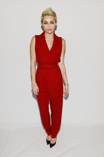 Miley Cyrus popped in a red Rachel Zoe jumpsuit and pointed Jean-Michel Cazabat pumps at Zoe's show at New York Fashion Week.
