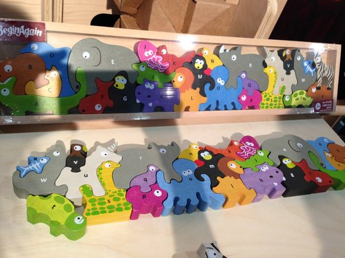The Animal Parade Puzzle from Begin Again is a fun learning tool for lil ones (and would make a great gift).