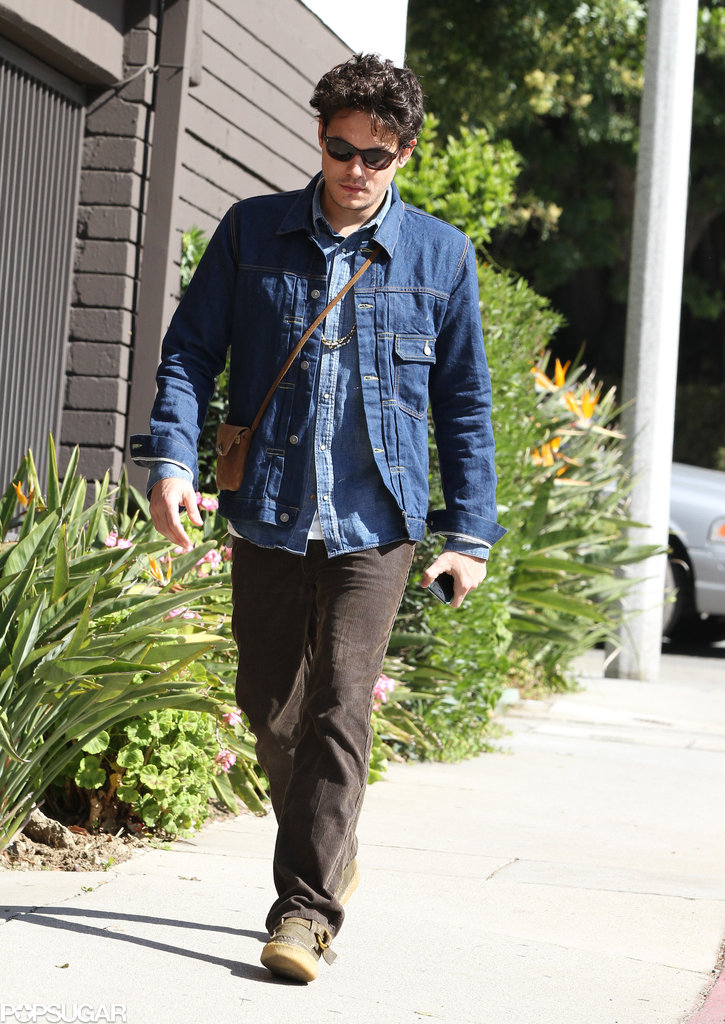 John Mayer carried a small bag with him.