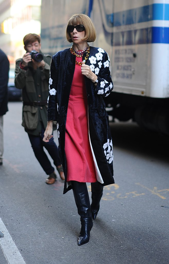 Anna Wintour made her way into the Calvin Klein show in a floral Prada coat, a pink dress, black leather knee-high boots, and a few sparkly necklaces.