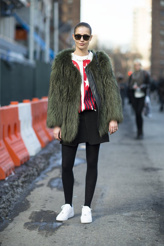 A statement-making fur is well-suited to practically any outfit — even an understated t-shirt and skirt. Source: Le 21ème | Adam Katz Sinding
