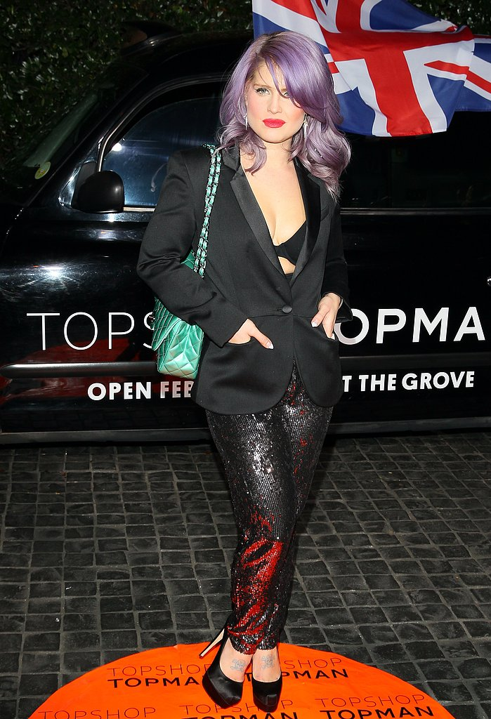 Kelly Osbourne stepped out in a shimmery trouser look, punched up further by her bralette-and-blazer combination.