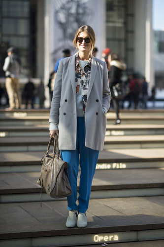 A simple, double-breasted coat was a perfect complement to her bright trousers. Source: Le 21ème | Adam Katz Sinding