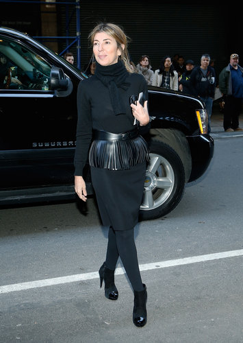 Nina Garcia's all-black ensemble on her way into Calvin Klein was anything but boring. Her leather fringe belt and cap-toe pumps added just the right amount of interest.