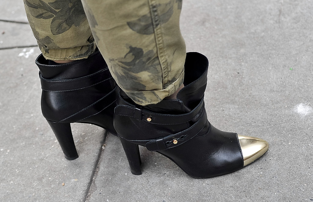 Gold cap-toes on these Stuart Weitzman boots gave them a glam-rock feel.