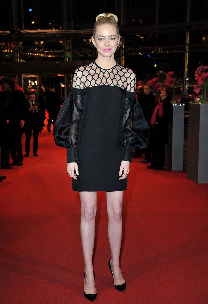 Emma Stone hit the red carpet in a black Gucci dress.