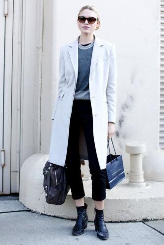Cropped trousers were just the right length to show off this show-goer's ankle boots.