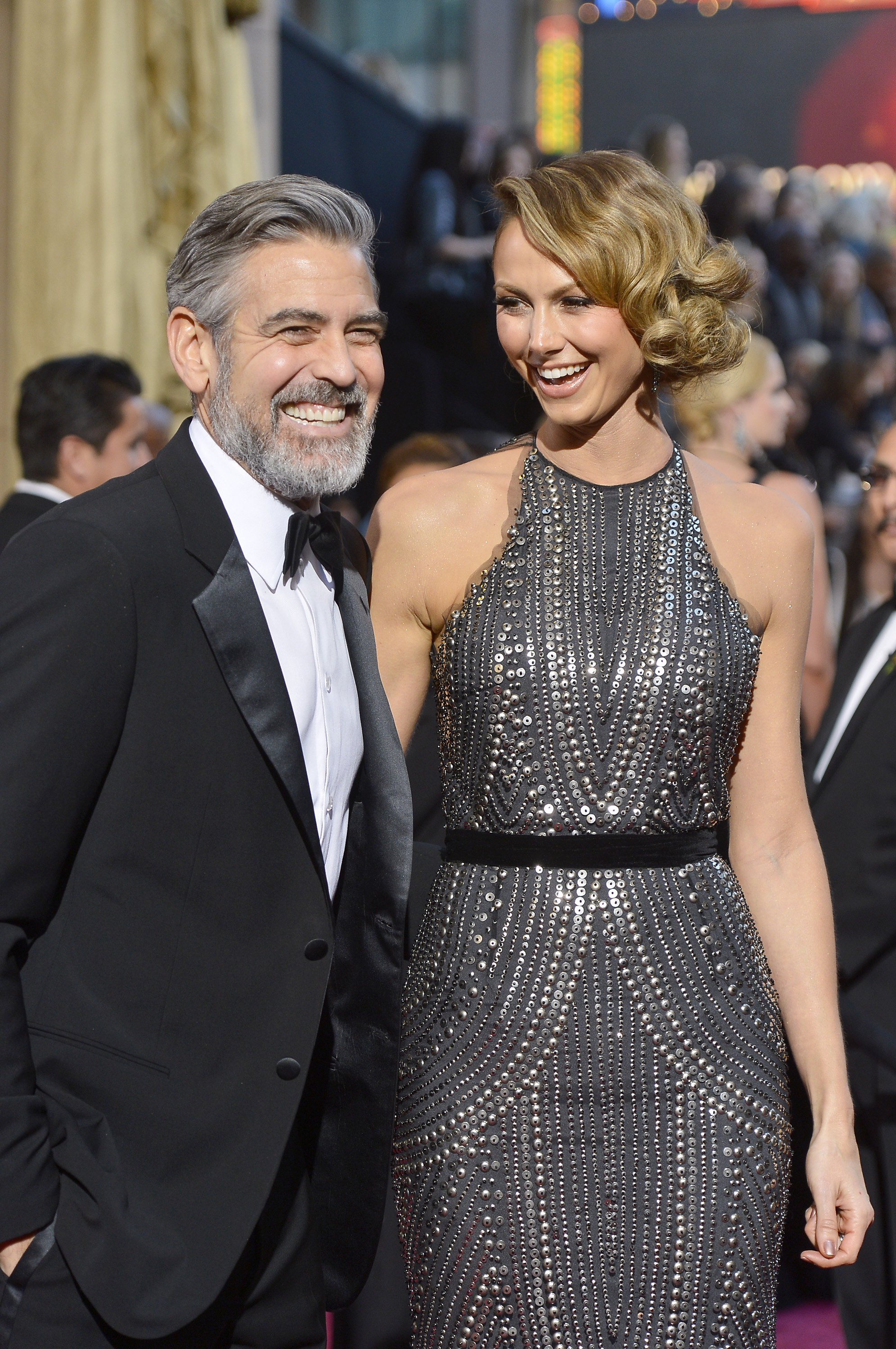 Stacy Keibler and George Clooney focused on having a laugh.