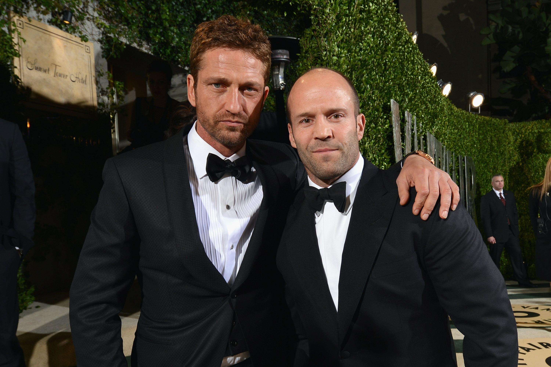 Gerard Butler and Jason Statham arrived at the Vanity Fair Oscar party on Sunday night.