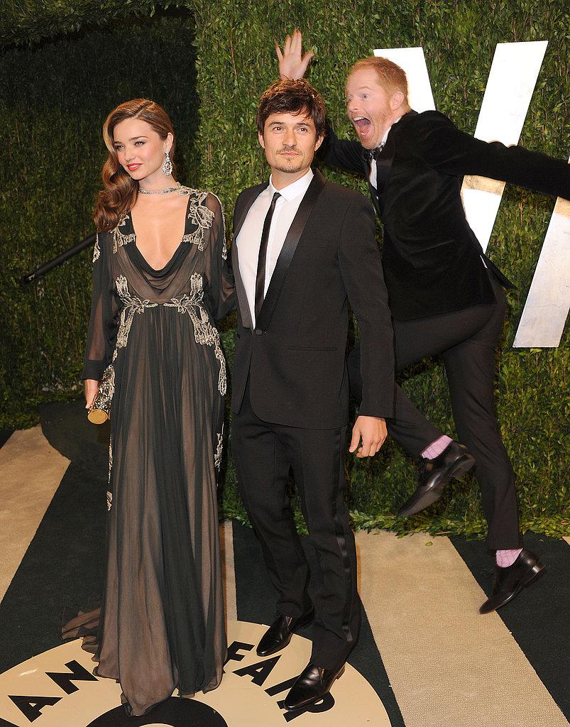 Jesse Tyler Ferguson photo-bombed Miranda Kerr and Orlando Bloom at the Vanity Fair Oscar party on Sunday night.