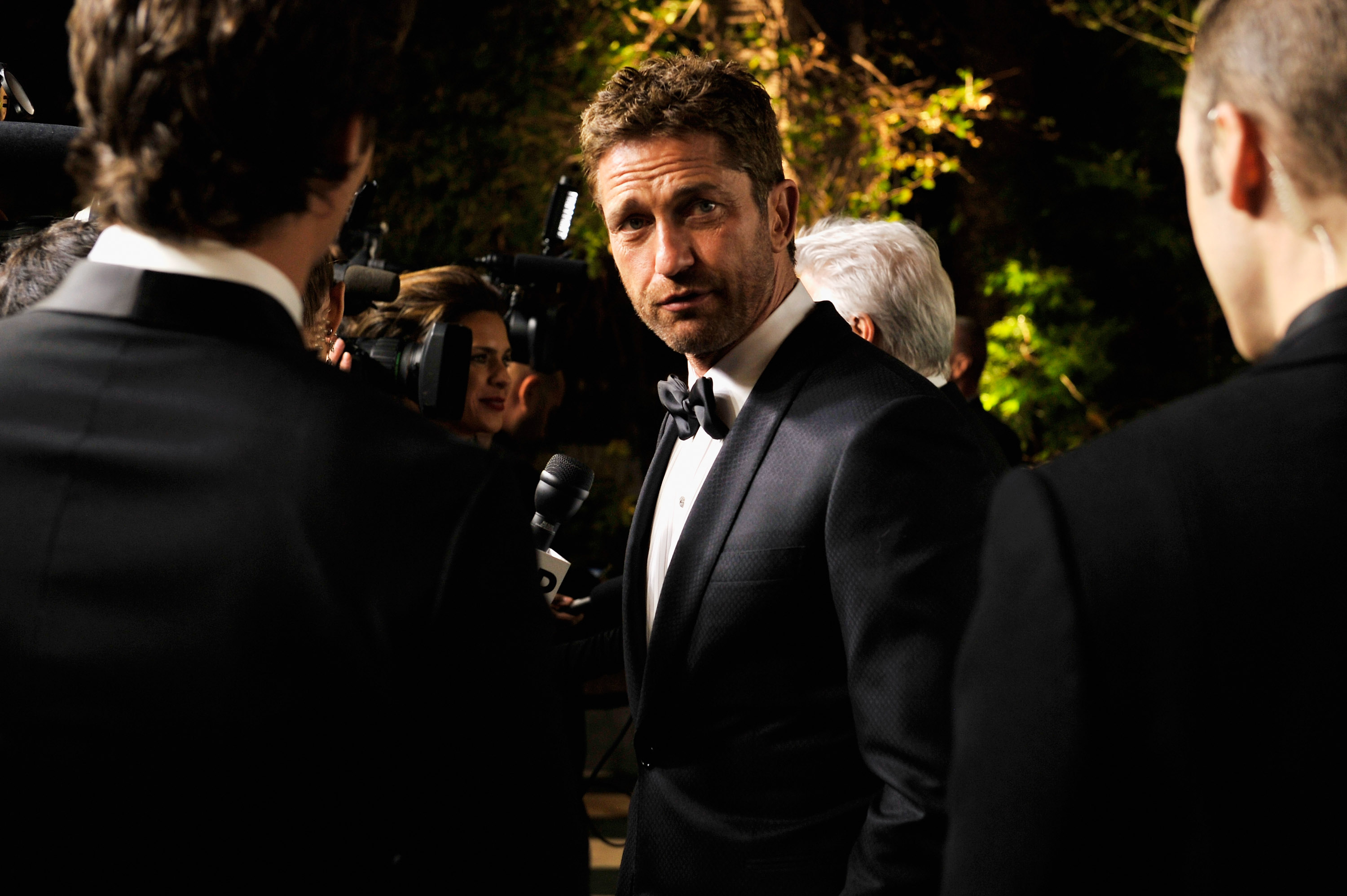 Gerard Butler arrived at the Vanity Fair Oscar party on Sunday night.