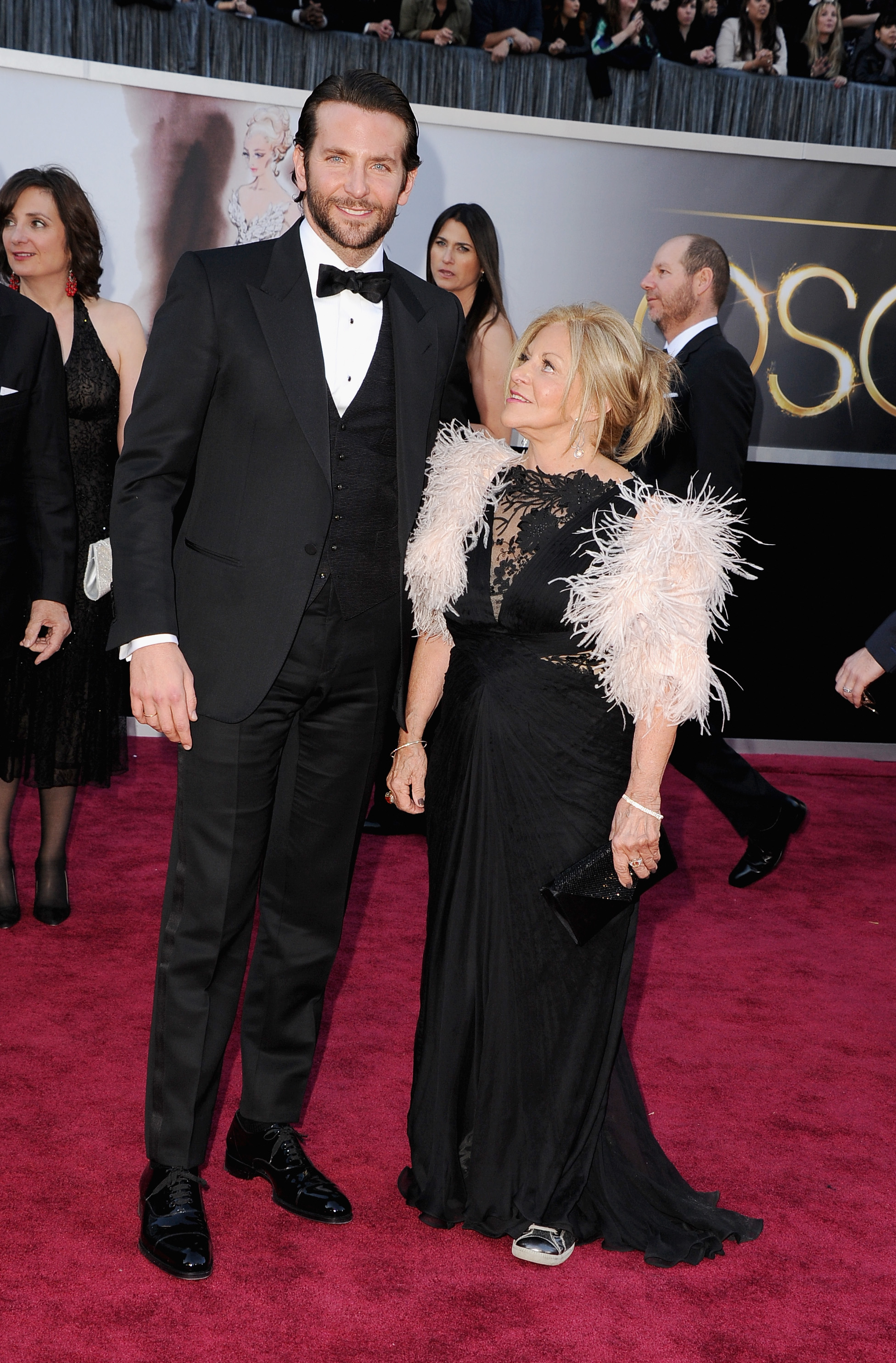 Bradley Cooper's mom sported sneakers on the carpet.
