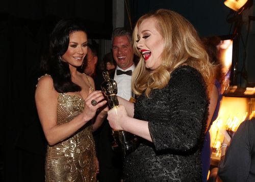 Catherine Zeta-Jones, Paul Epworth, and Adele gathered backstage at the Oscars.