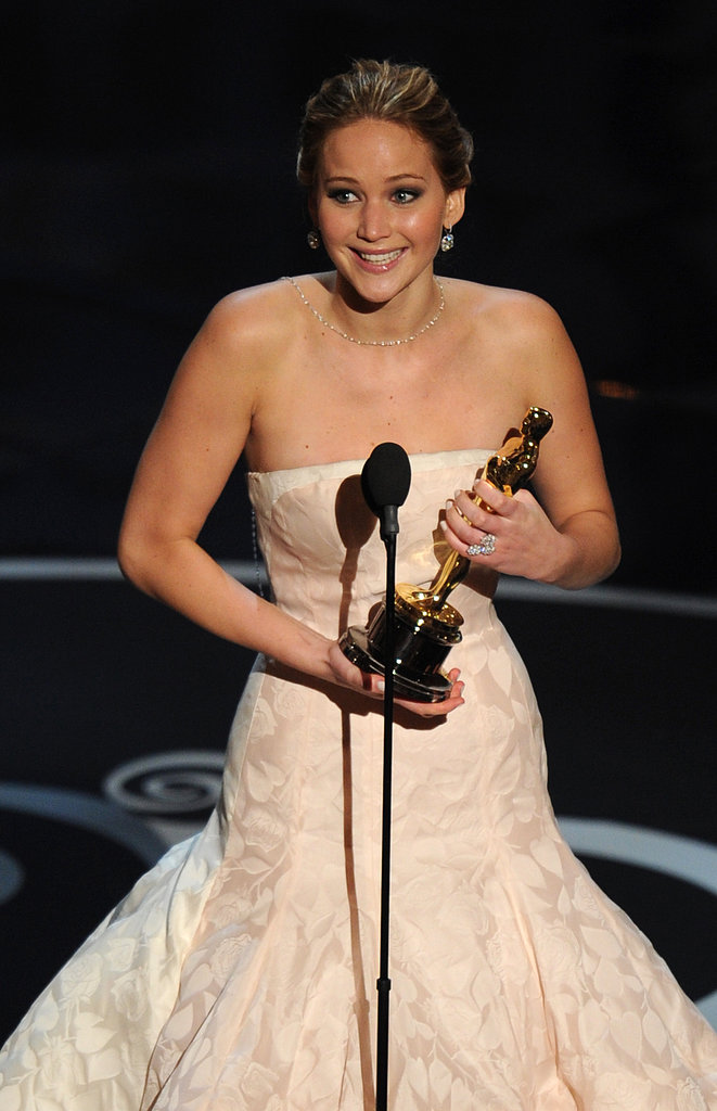Jennifer Lawrence on stage with her Oscar at the 2013 Academy Awards.