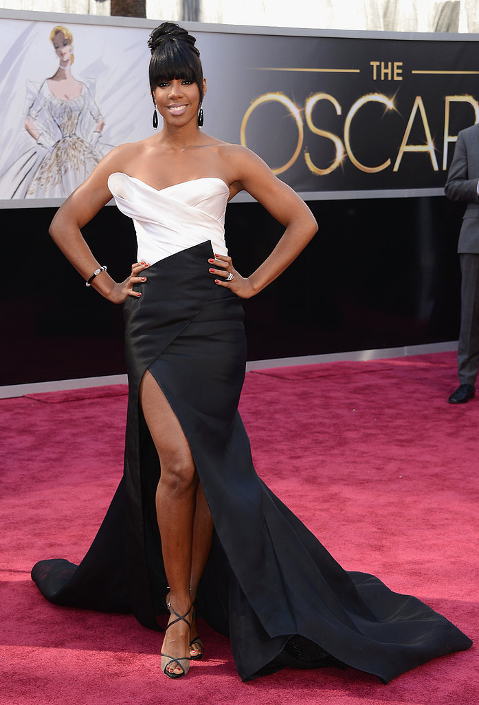 Kelly Rowland wore a black-and-white Donna Karan gown with a high slit for the Oscars.