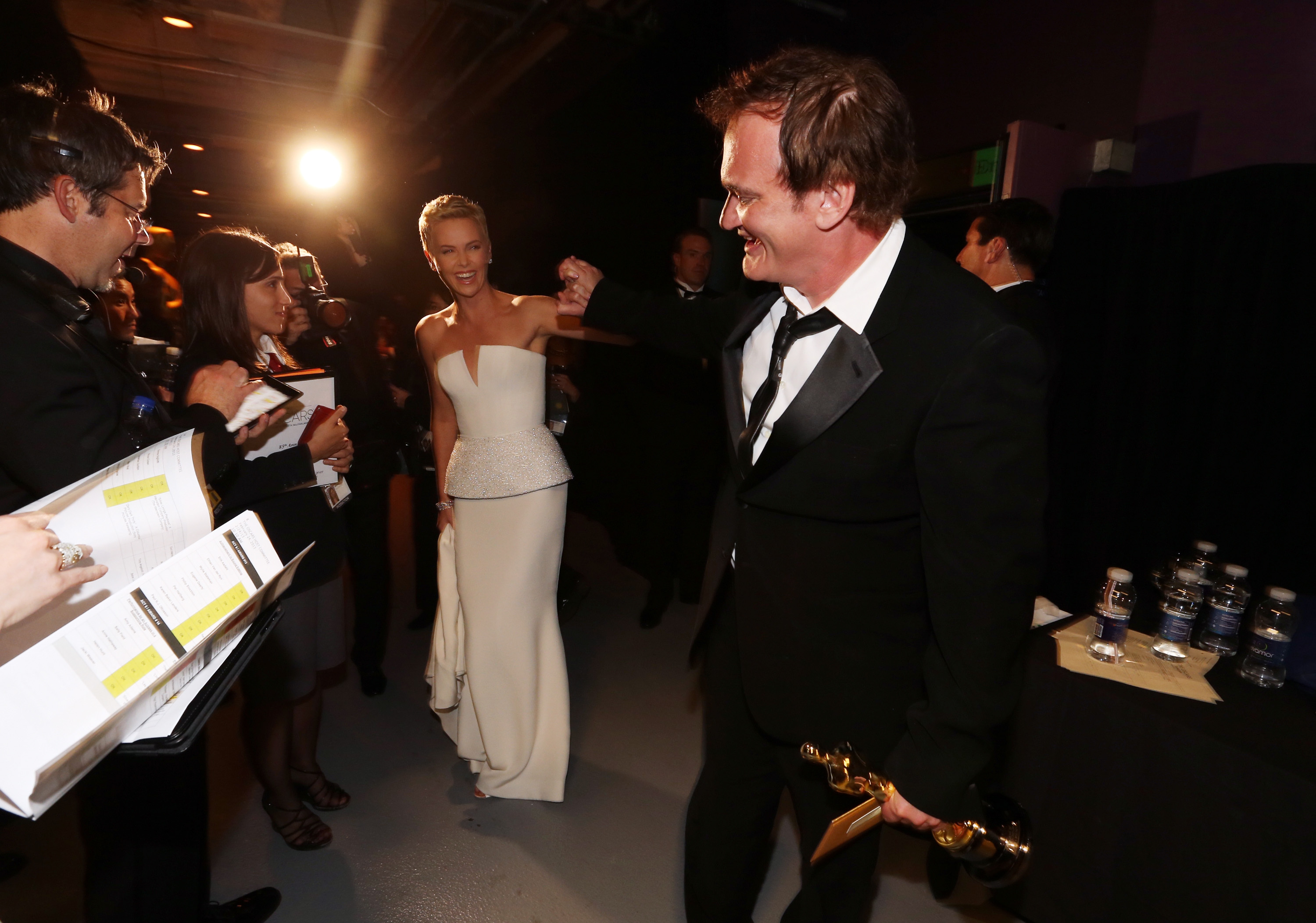 Charlize Theron motioned to Quentin Tarantino.