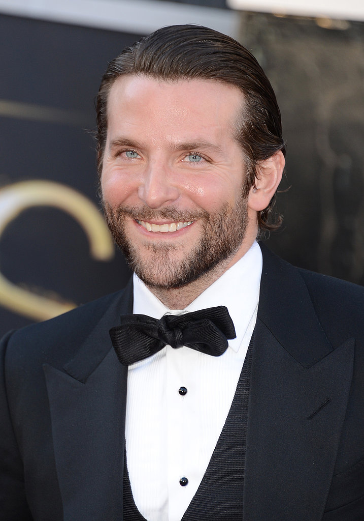 Bradley Cooper slicked his hair back to hit the Oscars red carpet.