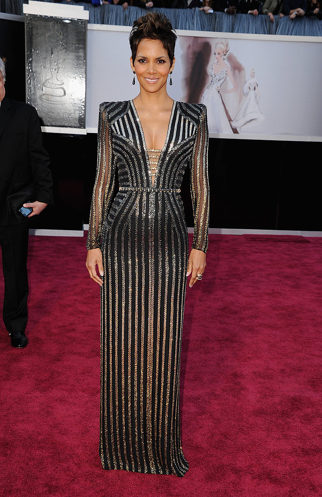 Halle Berry showed off her form in a sequined silver-and-black art deco-inspired Versace gown.