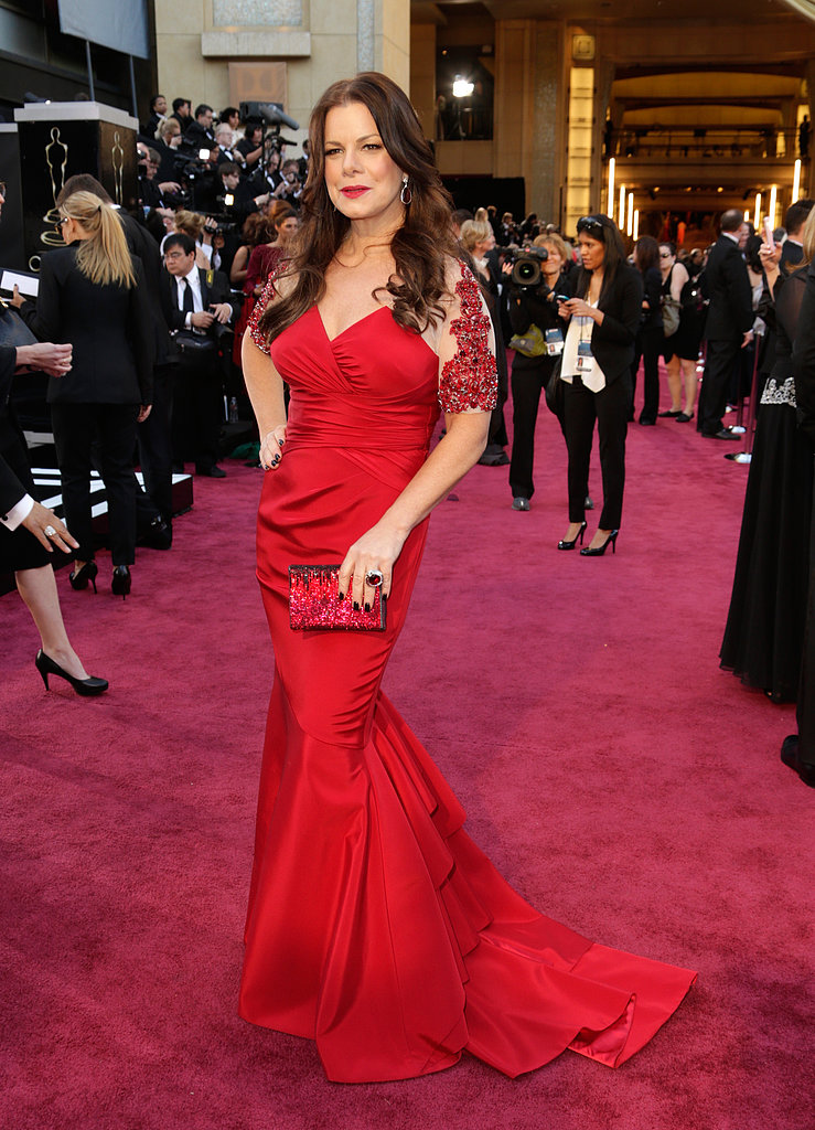 Marcia Gay Harden's body-con gown featured embellished half sleeves.