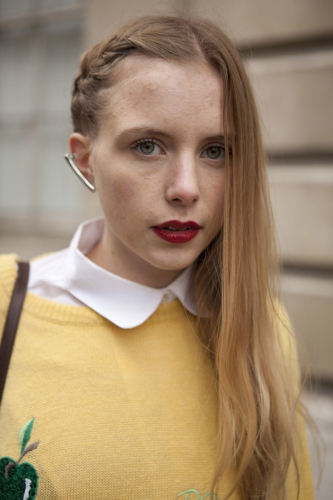 A braid/blowout hybrid style stayed grounded with a swipe of red lipstick.