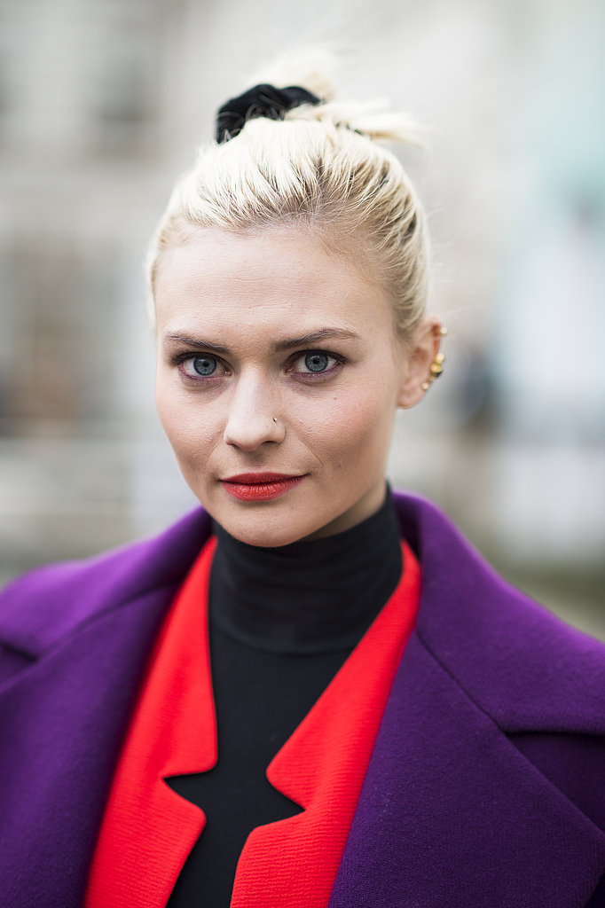 Is that a scrunchie we see? Paired with her purple liner and neon lips, Pandora Sykes was loving the '80s. Source: Le 21ème   Adam Katz Sinding