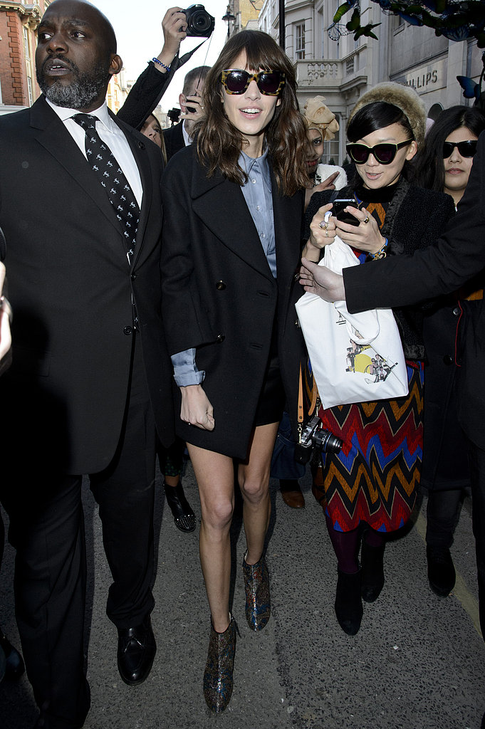 Alexa Chung wore shorts and a black coat to London Fashion Week events on Sunday.