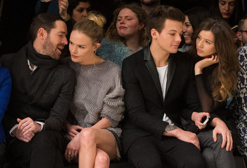 Kate Bosworth snuggled with Michael Polish while sitting next to Louis Tomlinson and Eleanor Calder at London's Topshop Unique Fall 2013 fashion show in February.