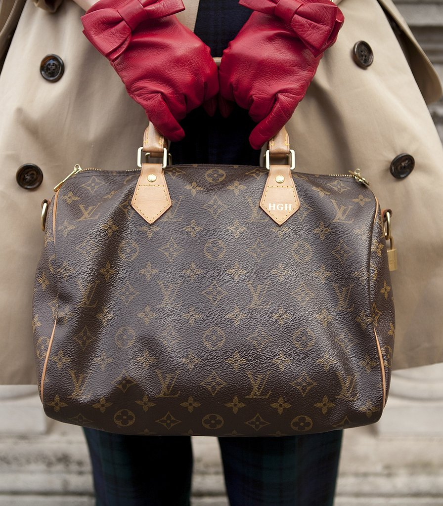 Louis Vuitton bag, red gloves, and a trench coat made for a polished pairing.