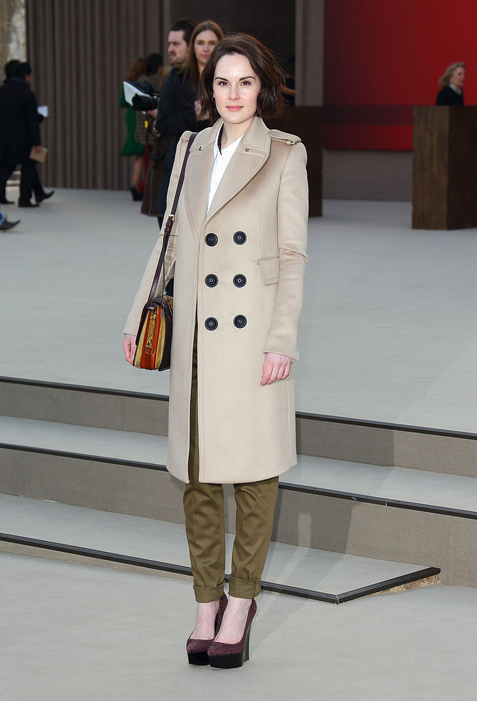 Michelle Dockery played around with neutrals in a beige double-breasted coat and olive cargos at Burberry.