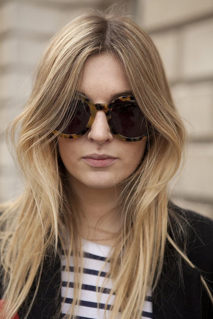 Oversize tortoise sunglasses added a '70s touch to this street-style look.