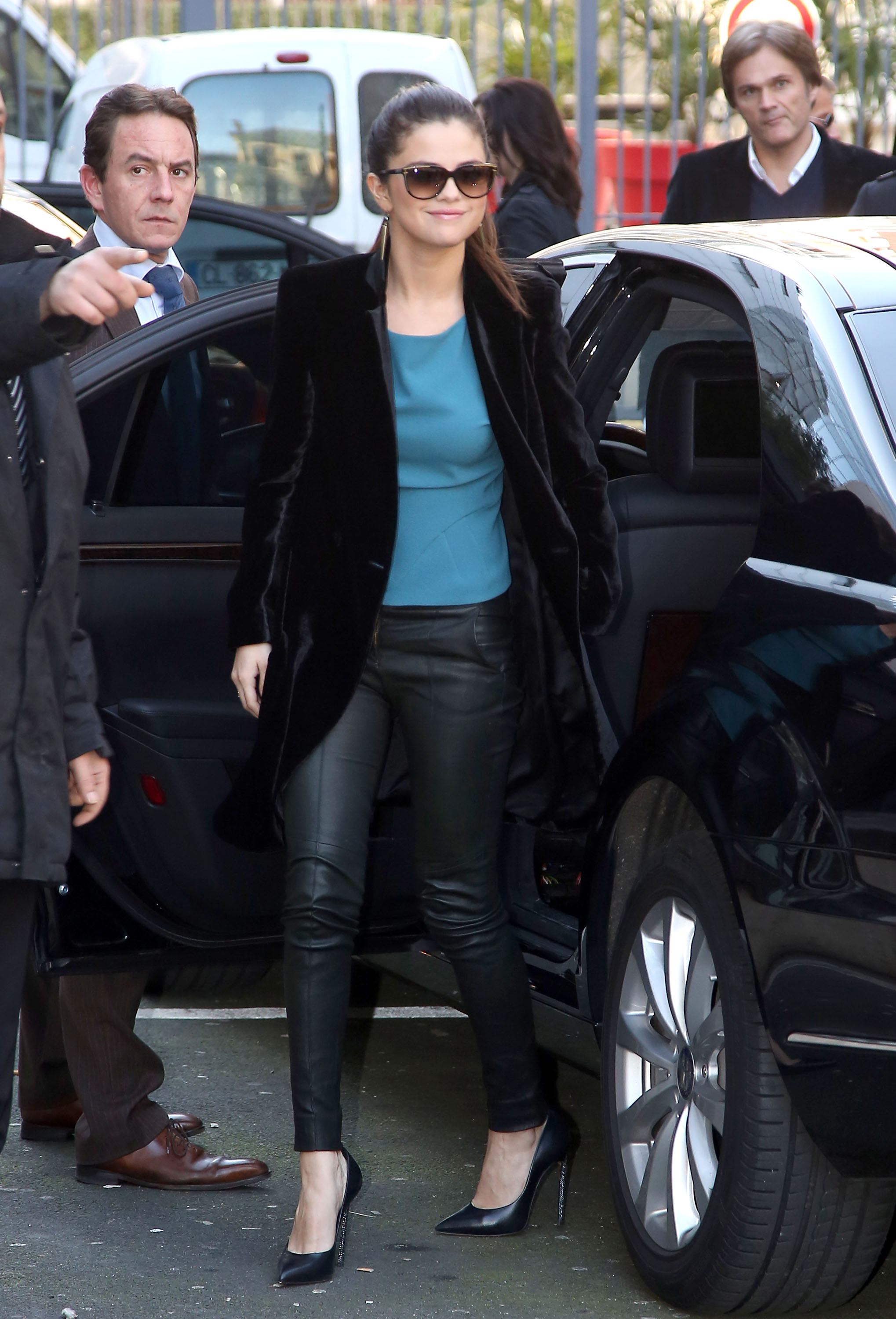 While making her rounds for press, Selena Gomez looked polished in black leather pants, a blue top, and a black velvet blazer.