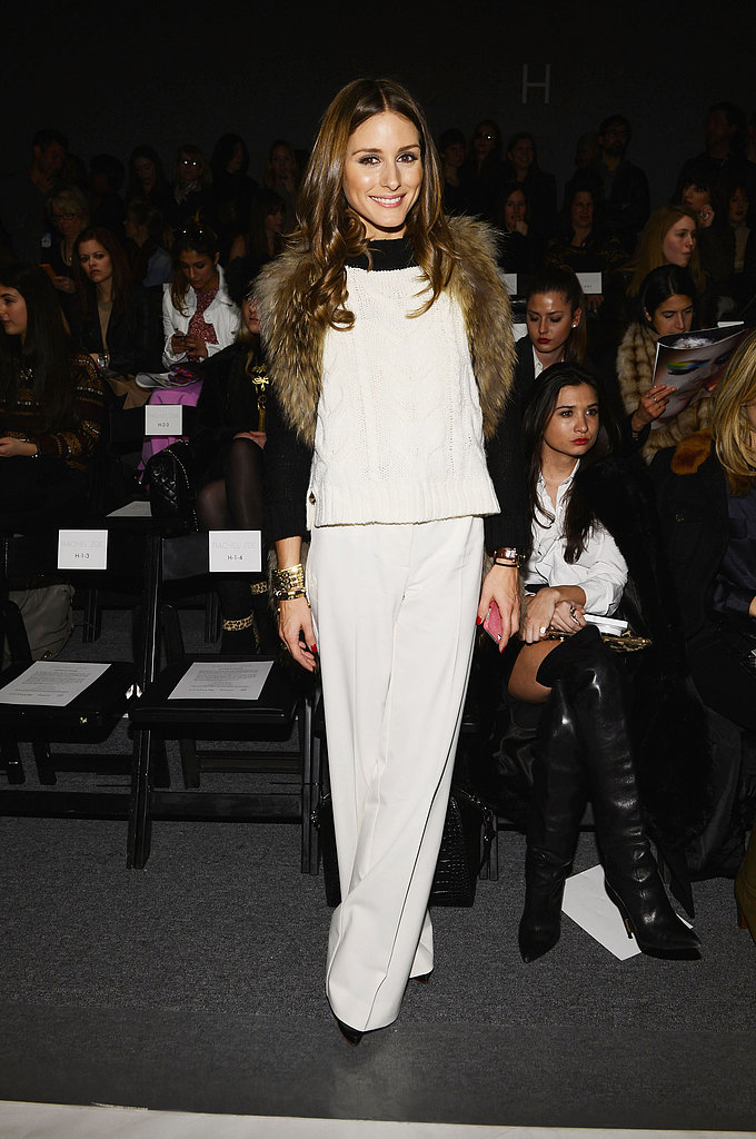 We love how Olivia's furry vest lent a touch of texture to her colour-blocked top and slick white trousers at the Rachel Zoe show in NYC.