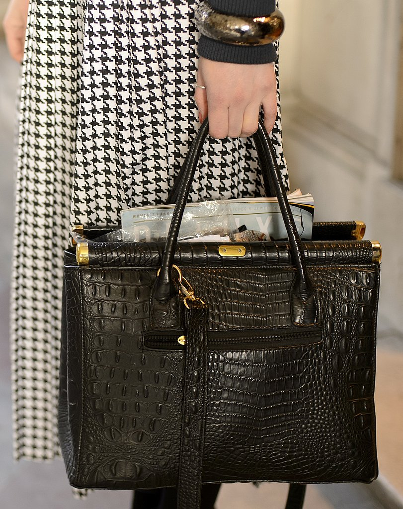 Gold hardware and a reptilian print gave this ladylike satchel a luxe touch.