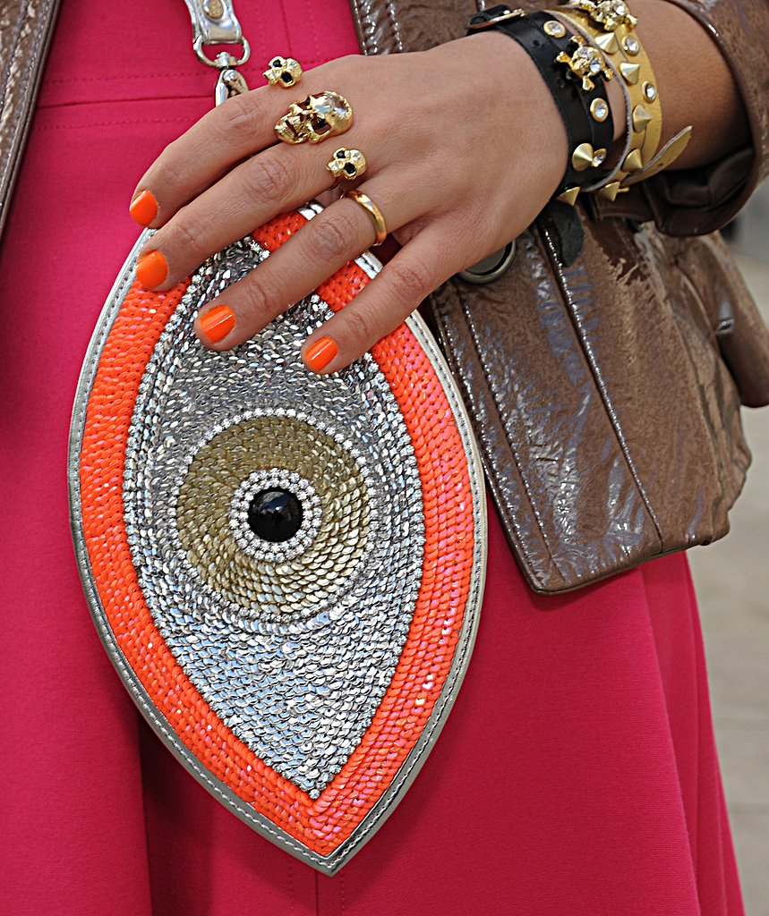 From the shimmery clutch to the black and gold jewels, we can't stop staring at this dazzling accessory pairing.