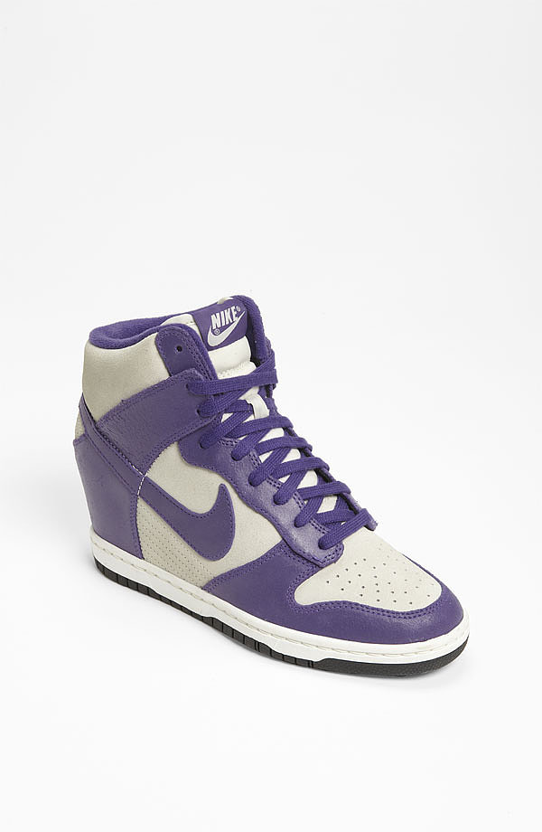 """If you haven't invested in a pair of wedge sneakers yet, then nab Nike's supercool """"Dunk Sky Hi"""" Wedge Sneaker ($80, originally $120) before they sell out quick."""