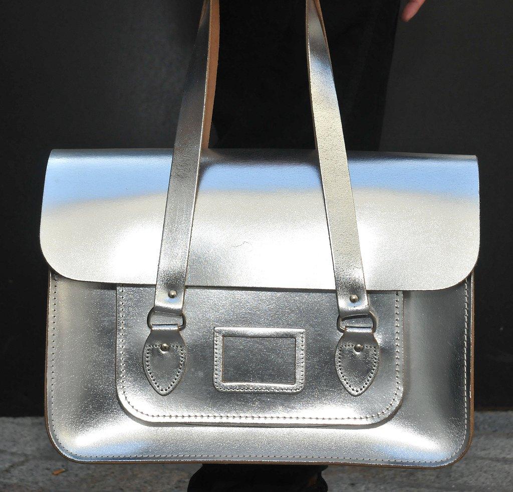 A metallic Cambridge Satchel Company bag stood out amongst dark accompaniments.