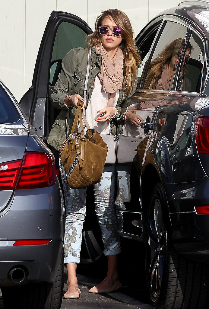 Jessica Alba took her cool outfit — green anorak, wrap scarf, and pastel print denim by Citizens of Humanity — to new heights via a suede Jimmy Choo bag and mirrored Westward Leaning sunglasses in Santa Monica.