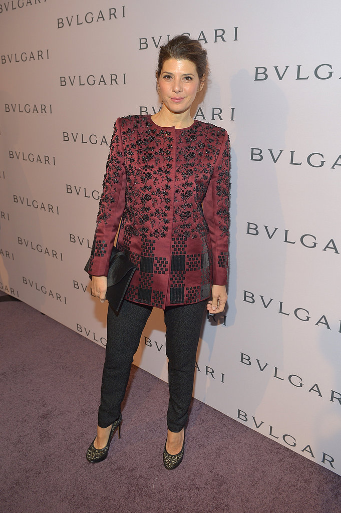 Marisa Tomei paired a silk embroidered coat with black trousers by Roksanda Ilincic and black lace pumps.
