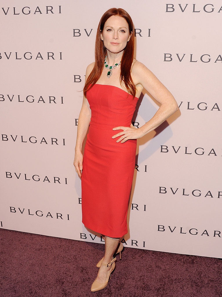 Brand ambassador Julianne Moore stunned in a red Alexander McQueen paired with nude ankle-strap pumps and a magnificent Bulgari emerald necklace from the Elizabeth Taylor collection.