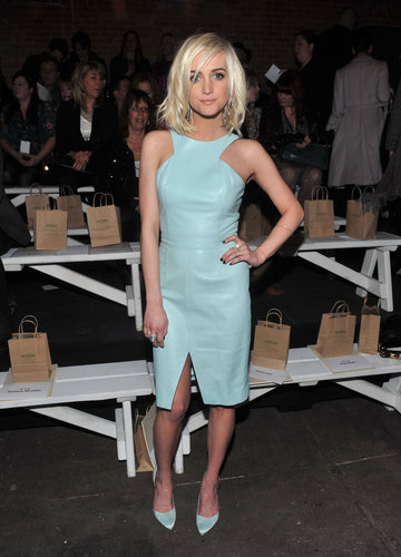 While sitting front row at Christian Siriano's Fall 2013 show in NYC, Ashlee Simpson dabbled with the colored leather trend in a knee-length blue leather dress and matching satin pumps.