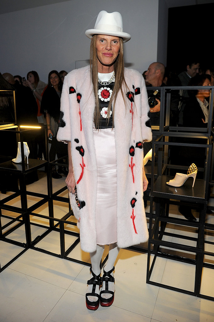 Anna Dello Russo stood out in her white fedora, floral fur coat, and platform sandals at the Sergio Rossi presentation at Milan Fashion Week.